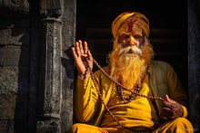 Kathmandu, Nepal, Pashupatinath Temple, beads, bearded man, holy man, man, old man, sadu, yellow