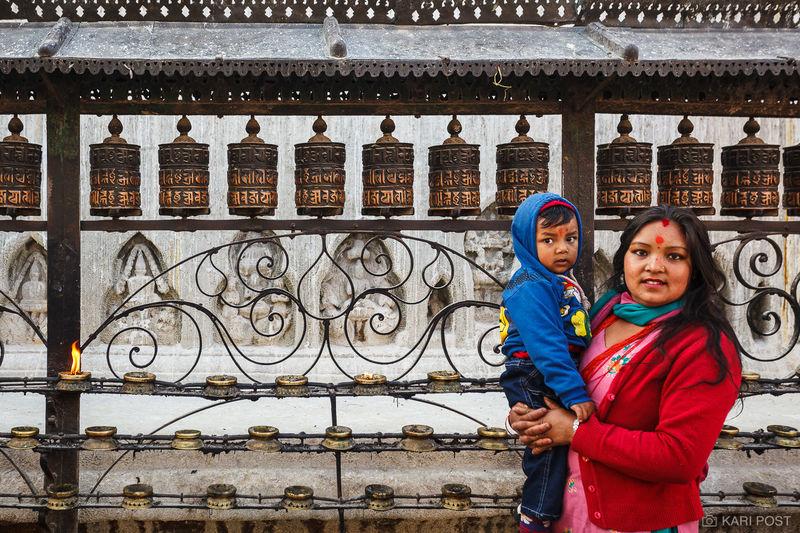 Kathmandu, Nepal, Nepali, child, mother, prayer wheel, red