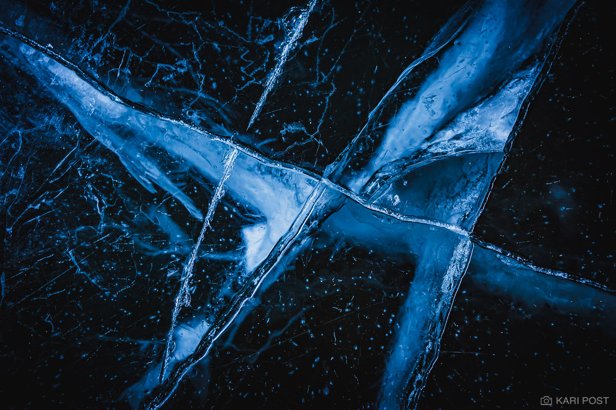 Bubbles and cracks on the surface of ice in a frozen cave.